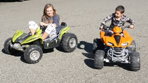 power wheels jeep yellow power wheels dune racers vs kawasaki quad youtube