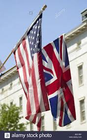 British Flag With Red American Flag Hanging With Union Jack British Flag Next To The