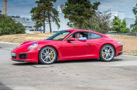 porsche carrera red on the road in the 2017 porsche 911 carrera s
