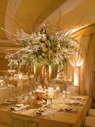 reception décor photos tall winter wedding flower arrangement