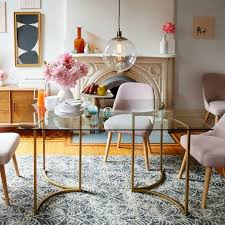 brass glass dining table and brass carraway dining table