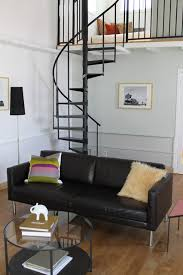 spiral staircases living room modern with black leather sofa black