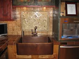 copper kitchen sink idea suits well in a farmhouse kitchen