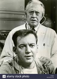 the actors bobby darin and carl benton reid in a scene from the