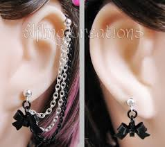 connecting earrings black and silver connecting bow chain earrings by merigreenleaf on