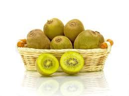 fruit in a basket ripe kiwi fruit in a wicker basket on a white background up
