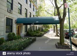 sidewalk canopy outside expensive luxury apartment building 1107