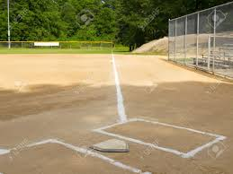 Home Plate by Home Plate And First Base Foul Line On A Small Town Ball Diamond