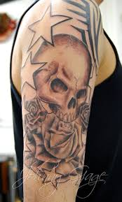 skull roses and tribal tattooed by johnny at flickr
