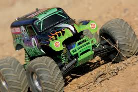 grave digger radio control monster truck bashing vs racing rc car action