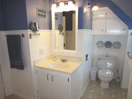 Wainscoting In Bathroom by Cottage Full Bathroom With Corian Counters U0026 Limestone Tile Floors