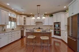 magnetic u shaped kitchen with island designs and 3 pendant light