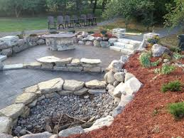 this is a sunken fire pit and seating area we repurposed her