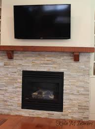 fireplace with wall mount tv earth tone stone surround solid