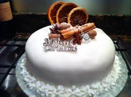 christmas cake decorated with dried oranges cinnamon stick