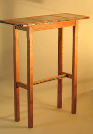 entry table of cherry wood marble and forged steel