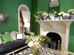 classic white fireplace offset by kelly green walls competing