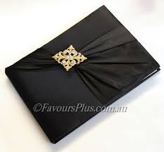 black guest book gold diamond brooch wedding guest book