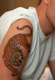 orange angry tiger on arm tattoomagz