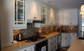 futuristic kitchen design with beautiful cream tile backsplash and