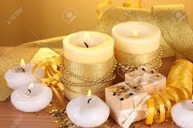 beautiful gifts beautiful candles gifts and decor on wooden table on yellow stock