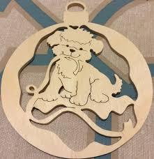 handmade scrollsawn wooden puppy with ribbon round scroll saw