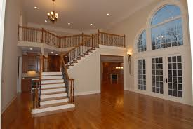 prefinished vs unfinished hardwood flooring brennan builders