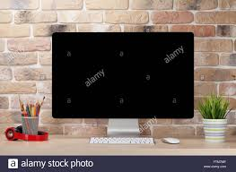 Wall Office Desk by Office Desk Workplace With Pc In Front Of Brick Wall Loft Style