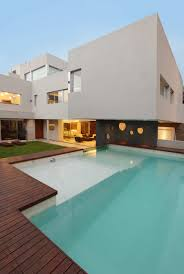 modern family home with glass swimming pool idesignarch