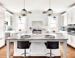 white kitchen islands 3 ways to use kitchen island modern lighting in a white kitchen