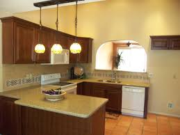 fab three track pendant lights over u shaped kitchen island and