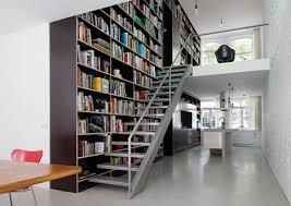 epic trilogy bookcase spans 3 levels of renovated loft