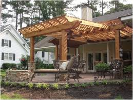 different shaped pergola makes a nice backdrop for the fire pit