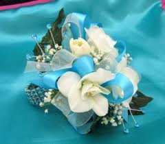 turquoise and white wrist corsage in portland me dodge the florist