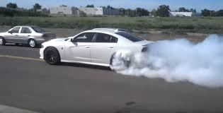 charger hellcat burnout enthusiastic new charger hellcat owner leaves dodge dealership with