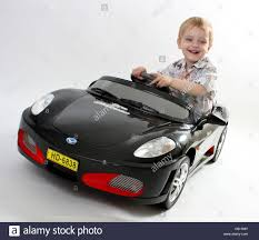 ferrari electric car a young toddler boy driving his black ferrari electric sit on ride