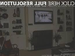 fireplace amazing how to hang tv over fireplace home design
