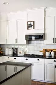 how to make cheap kitchen cabinets look better how to make a builder grade kitchen look custom hilltown house