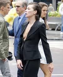 blouse nip slip milla jovovich suffers a nip slip at studded vogue shoot in