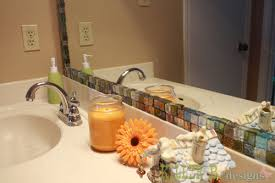 captivating framing a bathroom mirror with glass tile for