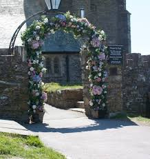 wedding arches uk like this concept with seasonal floral varieties to fit in with