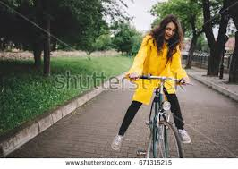 raincoat for bike riders cycling rain cheerful young woman riding stock photo royalty free