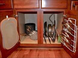 kitchen room hanging pots and pans in cabinet cookware racks