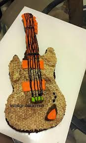 guitar cake topper indulgeashscorner guitar cake molded two tone choc wrap