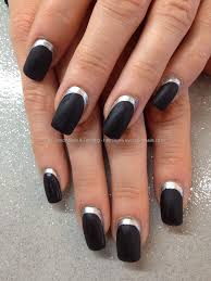 black matt polish with silver cuticle edge over acrylic nails