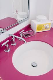 opposite color of pink pops of pink bathroom kohler
