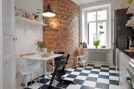 cuisine en brique decoration mur en brique carrelage retro meubles cuisine noir