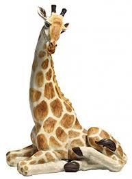 large giraffe statue resting floor garden ornament figure outdoor