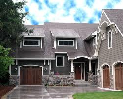 michigan house update new windows brown doors garage doors