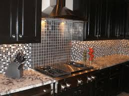 kitchen backsplash with stainless steel tiles wooden chair